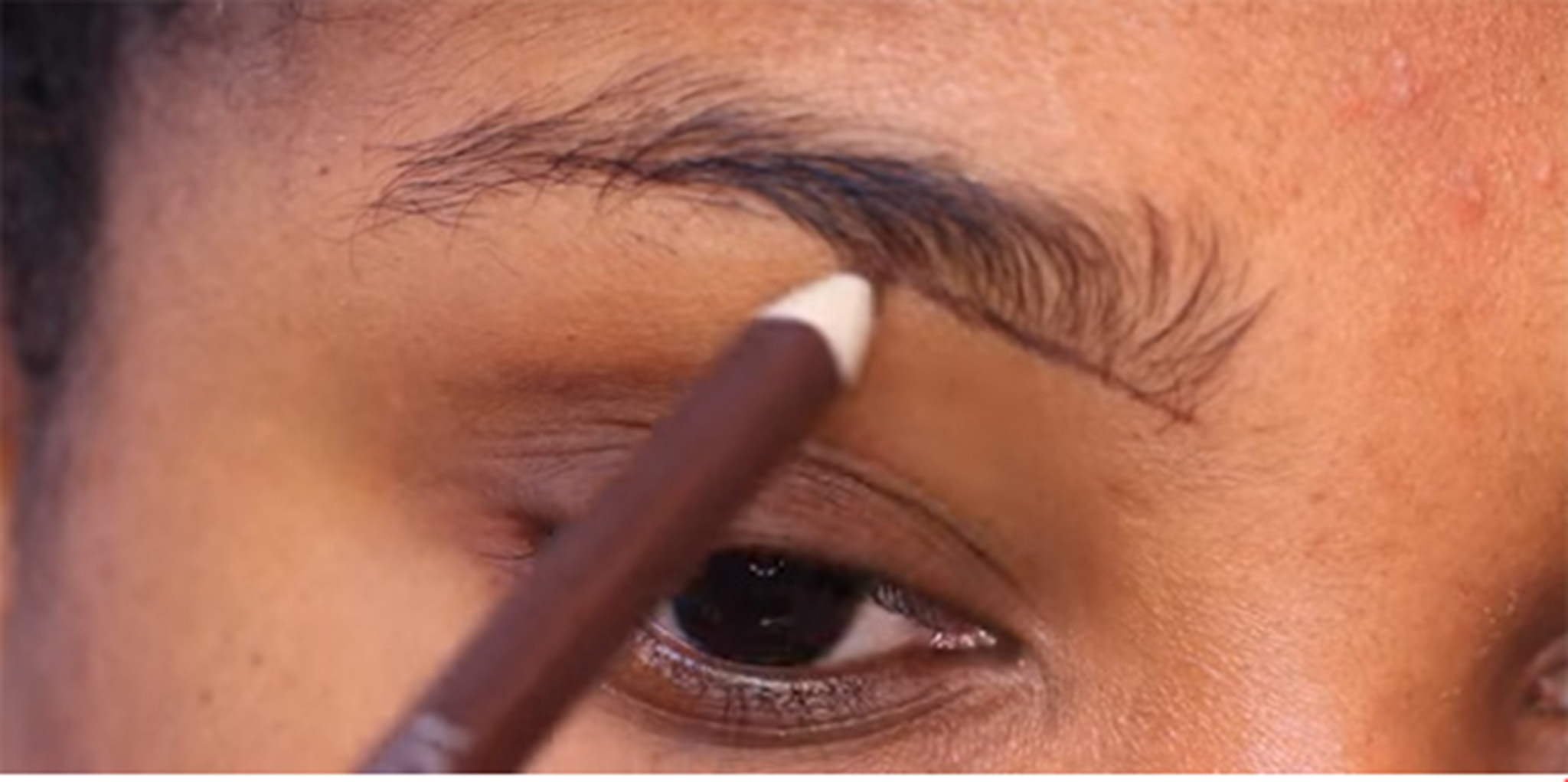 Take an eyebrow pencil and draw its corner and the desired shape you wish to make